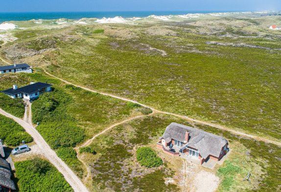 Hübsches Reetdachhaus auf Naturgrundstück mit Aussicht