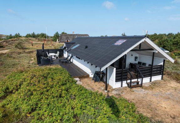Gemütliches Ferienhaus mit Kaminofen auf einem schönen Dünengrundstück
